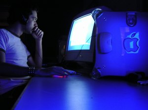 Man in front of computer at night
